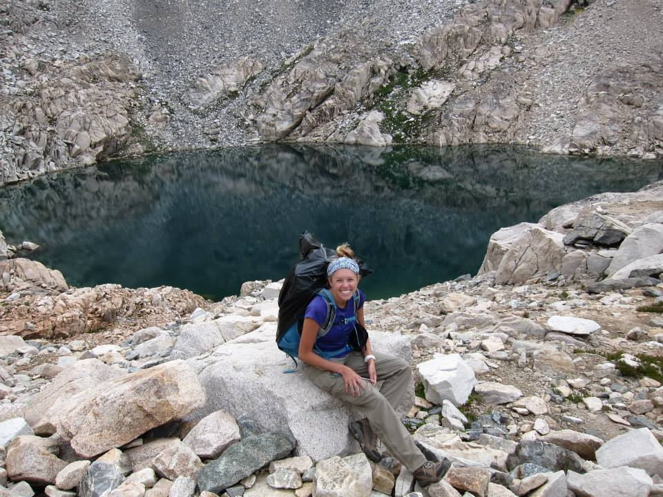 Girl in front of lake prior to hiking up Glen Pass