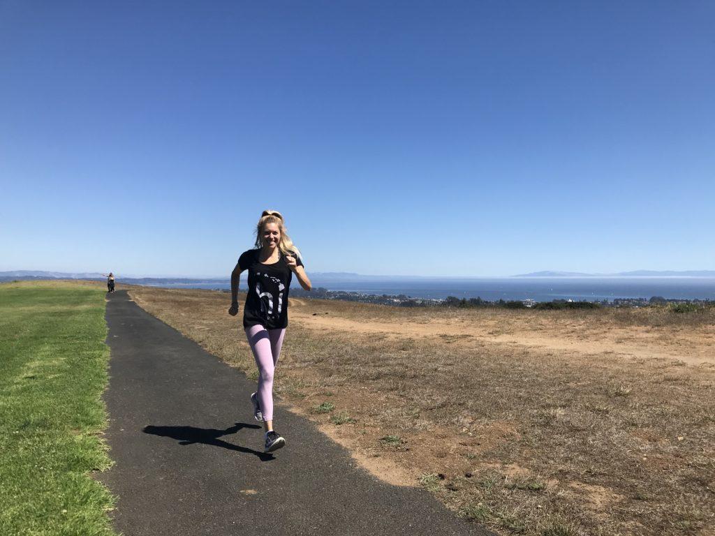 Girl on a run along the coast