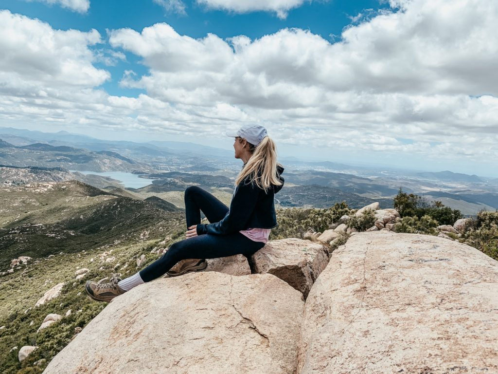 Girl on top of rock at a San Diego hike in Poway