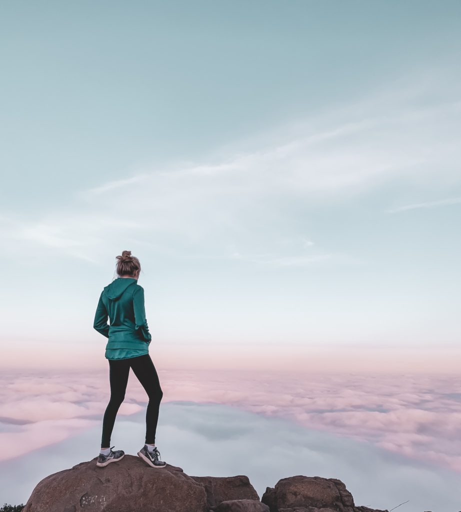 Girl hiking above the clouds at Cowel's Mountain