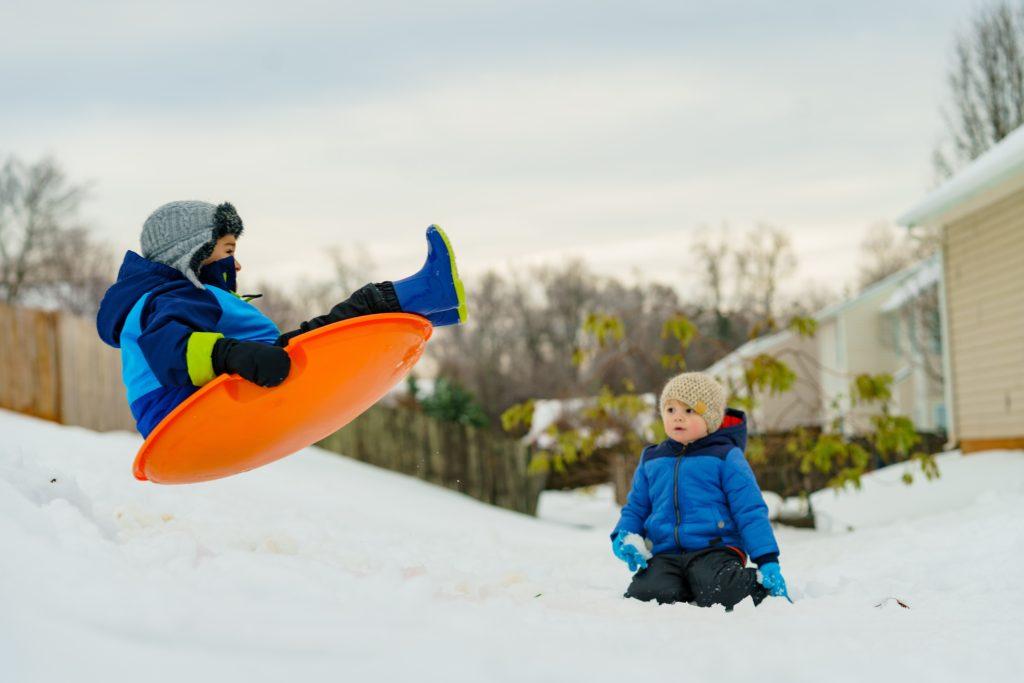 Kids sledding down a mountain