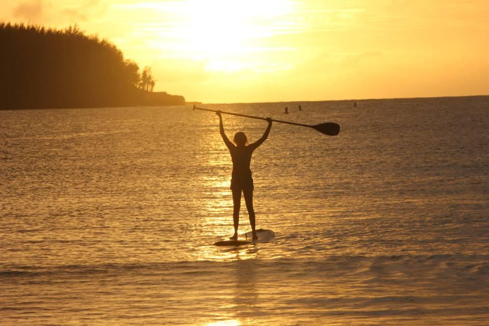 Girl sunset paddleboarding