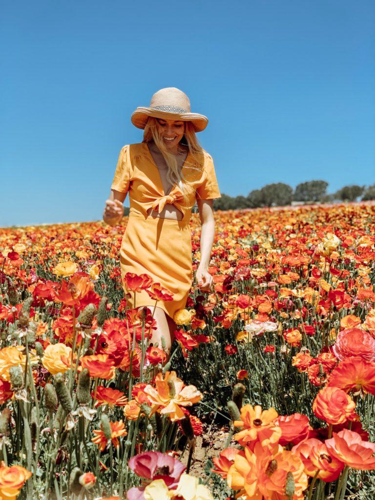 Girl walking through the flower fields in Carlsbad