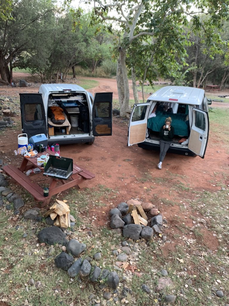 Car campers sleep in a campground