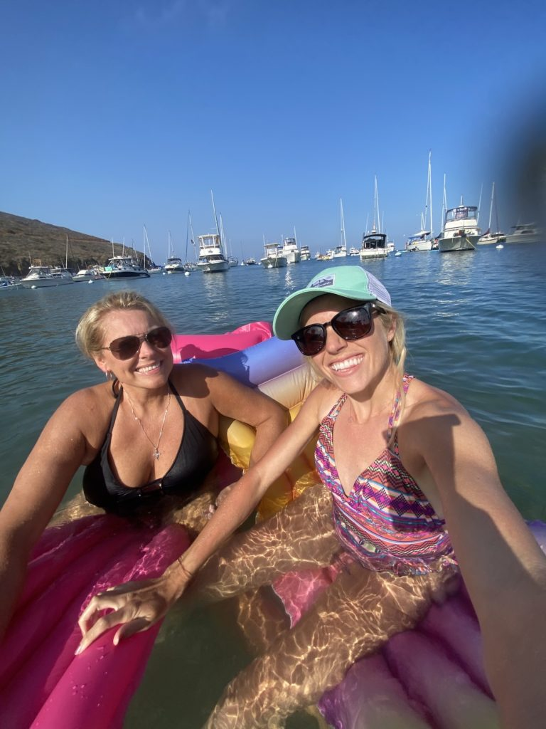 Mom and daughter relaxing in the water on Two Harbors