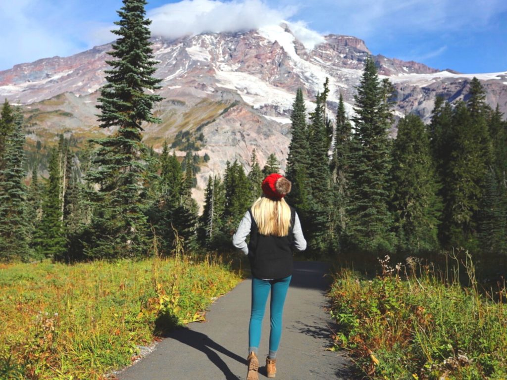 Girl wearing her hiking boots in front of Mt. Rainier