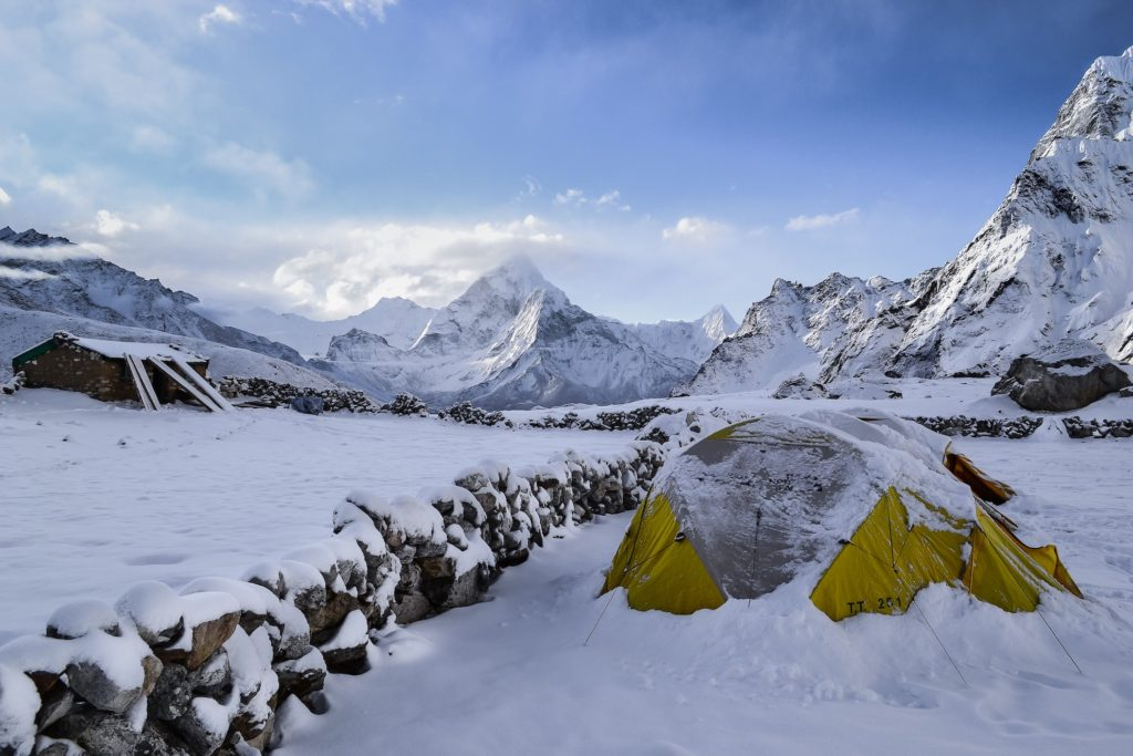 Another cold weather camping tip is block your tent form the wind