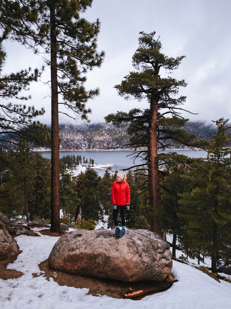 Girl hiking in Big Bear on a winter road trip from San Diego