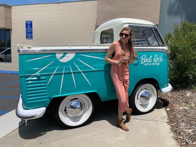 Girl in front of Bird Rock Coffee Roasters Van in San Diego