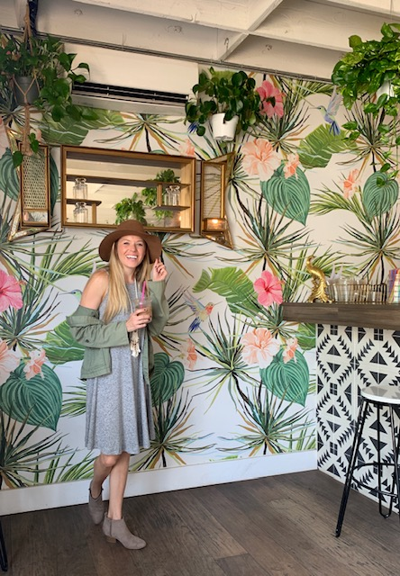 Girl in one of the most instagrammable coffee shops in San Diego called the Grounds Bean Bar