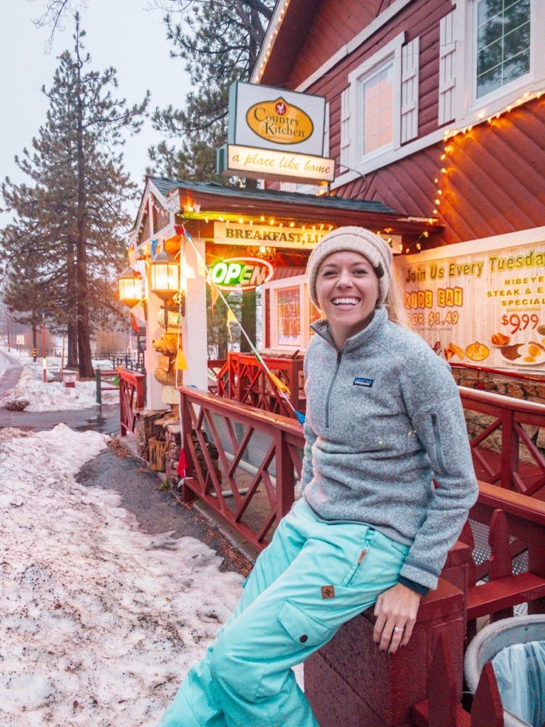 Girl at lodging in Big Bear as part of a winter road trip from San Diego