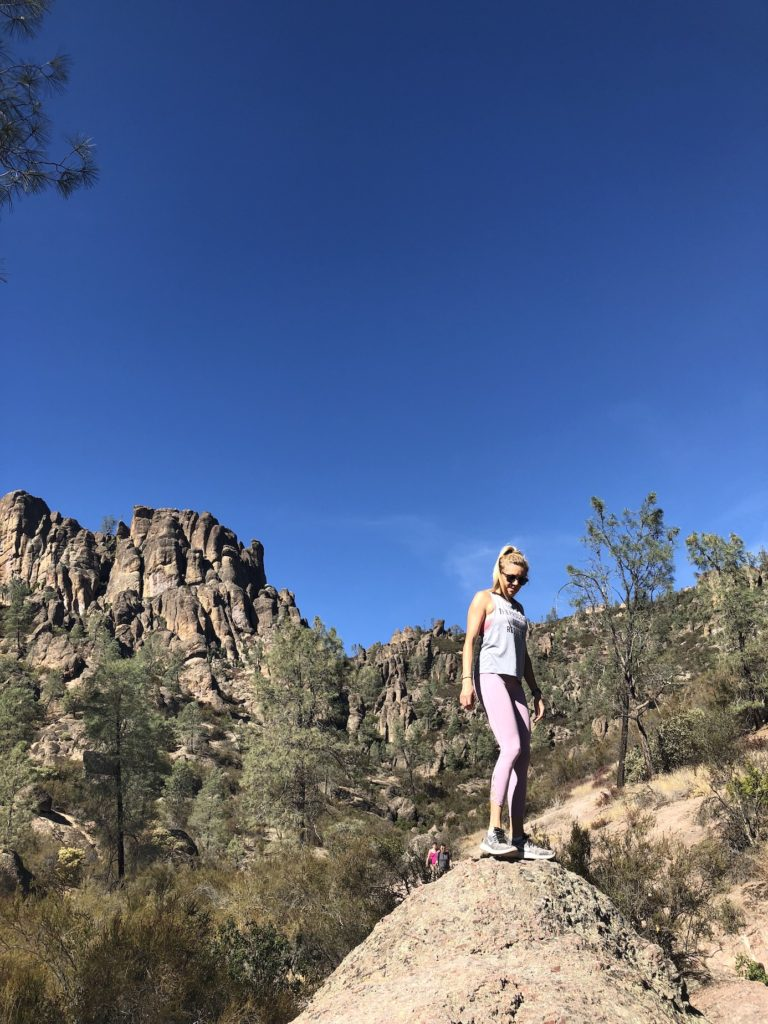 Chelsey on a rock in Pinnacles National Park one of the most underrated parks