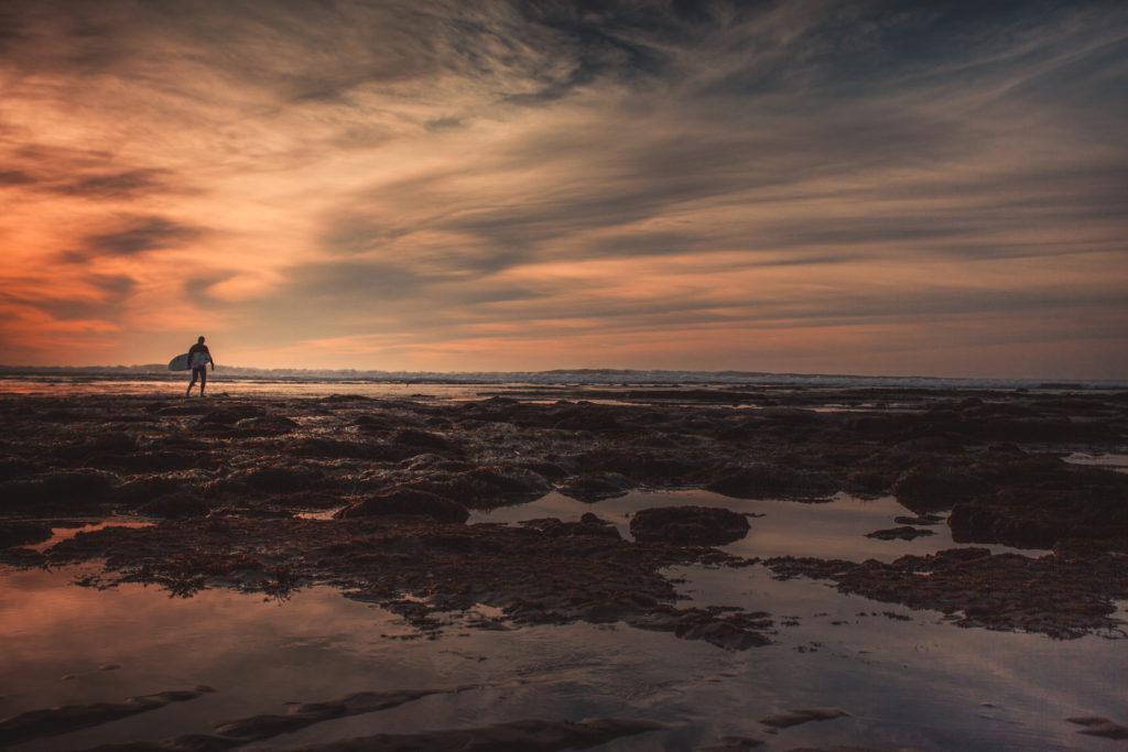 Sunset cliffs surfer at sunset