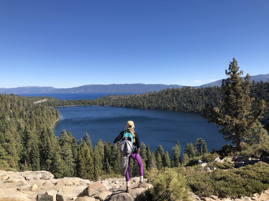 Chelsey standing on a rock overlooking Lake Tahoe