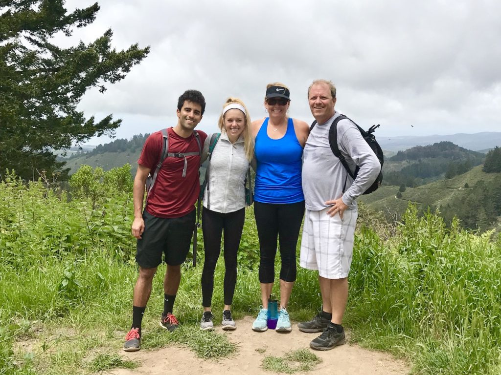 Family of four hiking the King's Mountain Loop in Redwood City