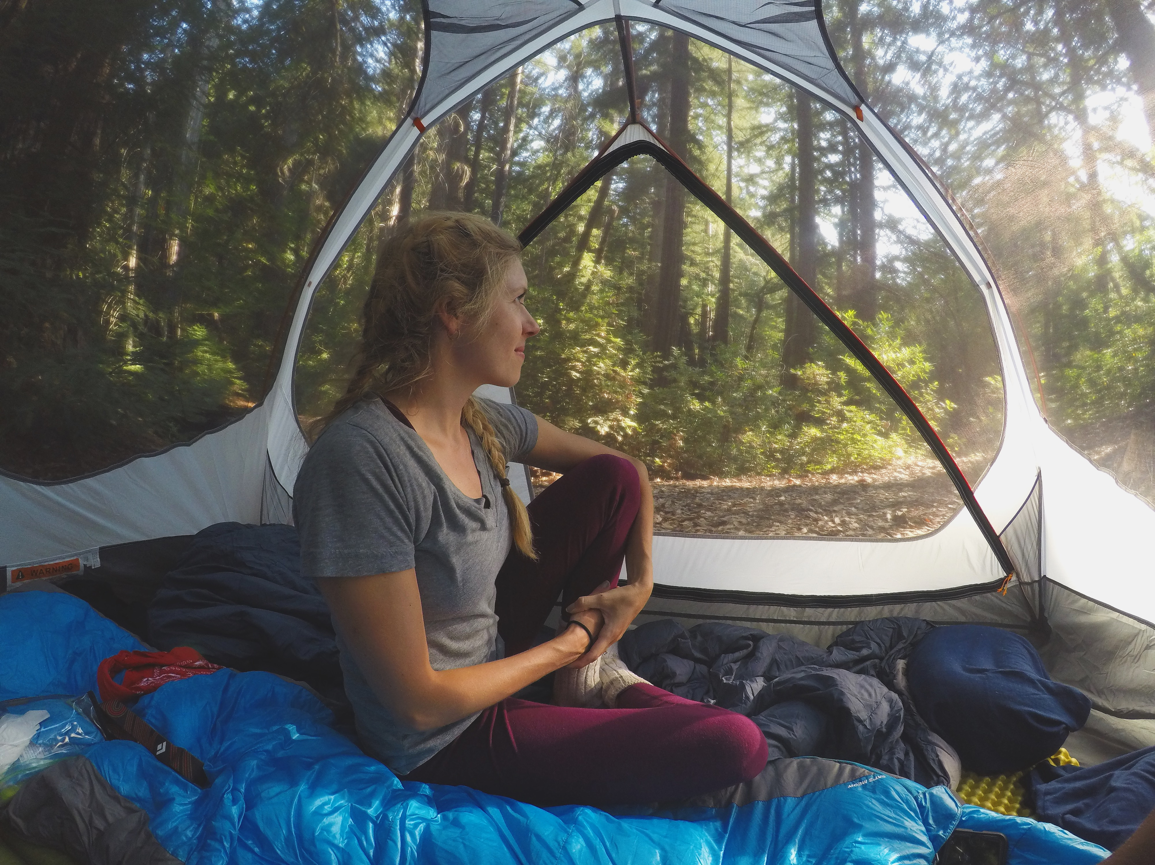 Girl sitting in tent
