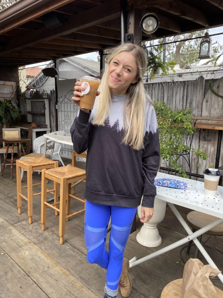 Chelsey holding a coffee at Garden Coffee: one of the best coffee shops in San Diego