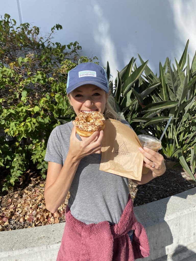 Chelsey eating a vegan donut from camp coffee in Oceanside
