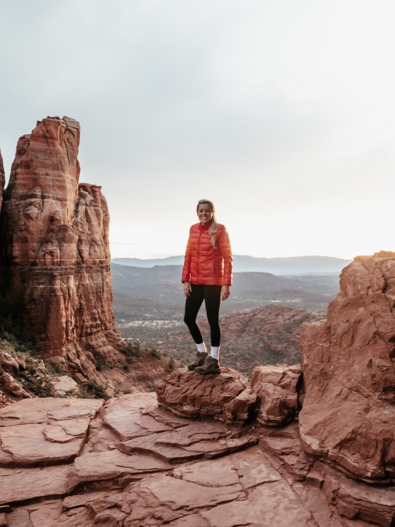 Girl standing at the top of Cathedral rock which is one of the best Sedona hiking trails