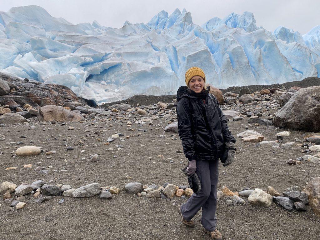 Girl standing up close to the Perito Moreno Glacier