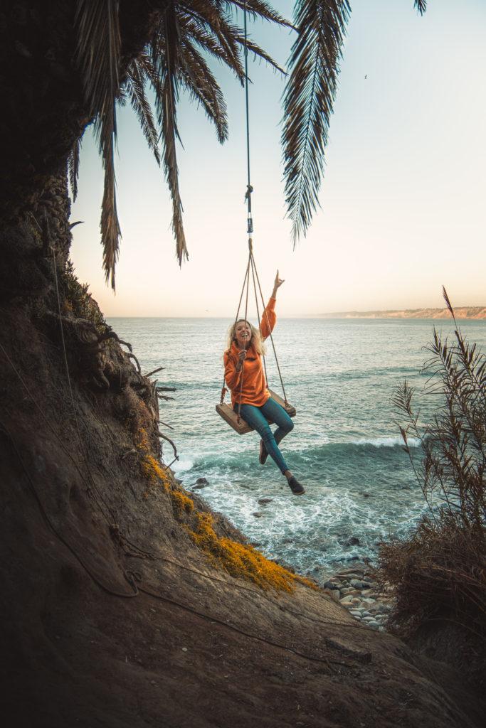 Girl swinging on the La Jolla Swing