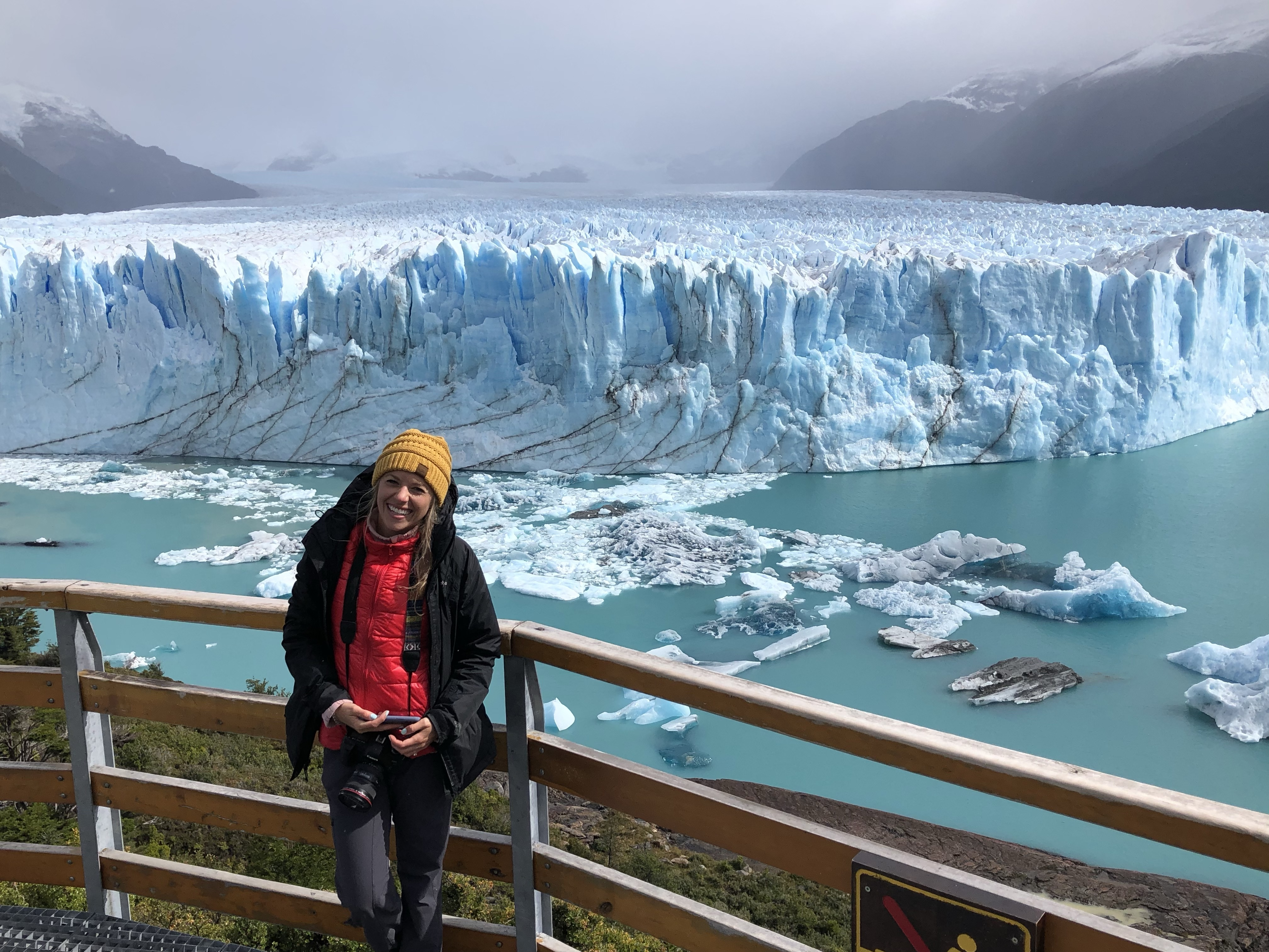 Girl standing on boardwalk with views of the Perito Moreno Glacier in the background