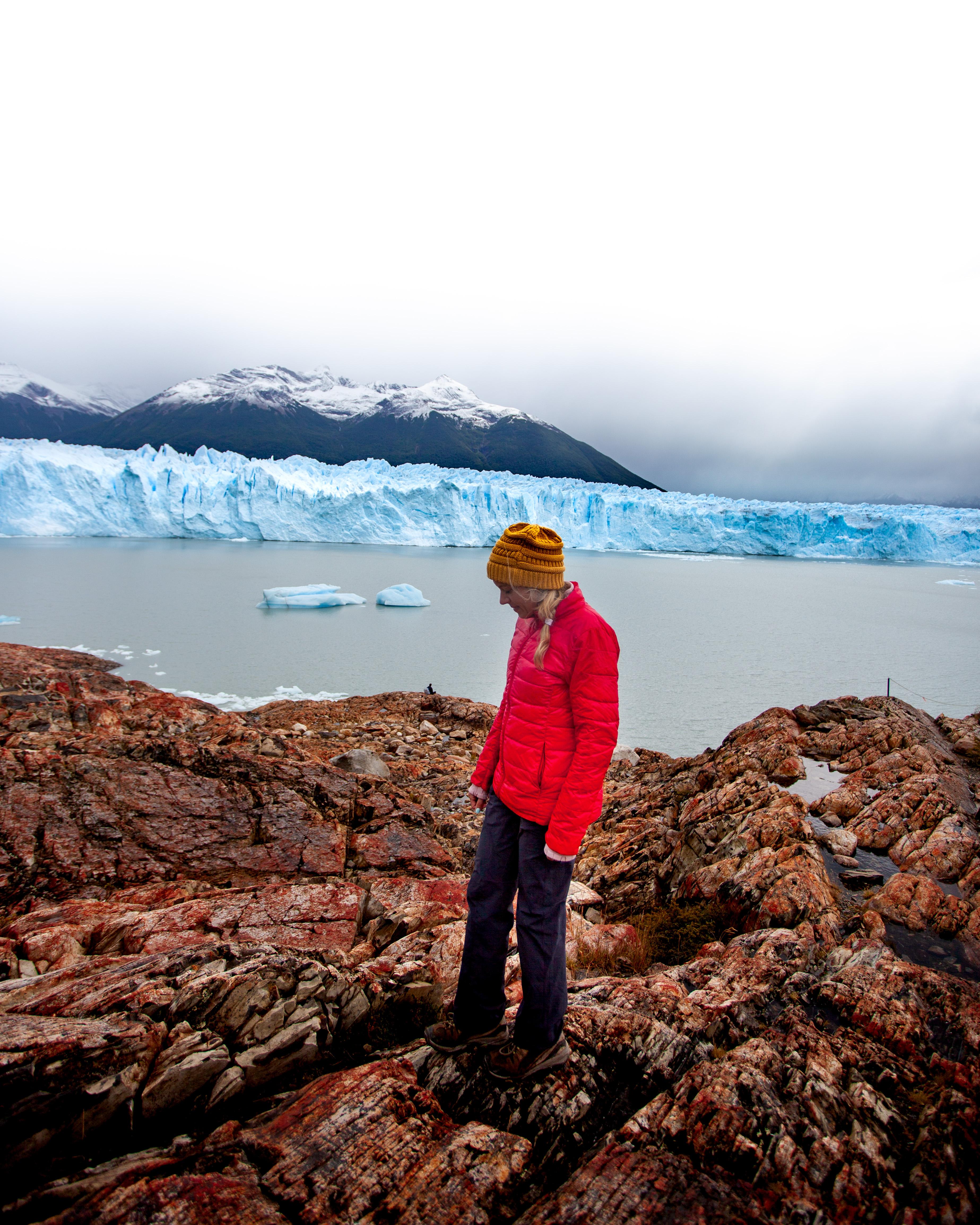 Girl walking in front of the Perito Moreno Glacier
