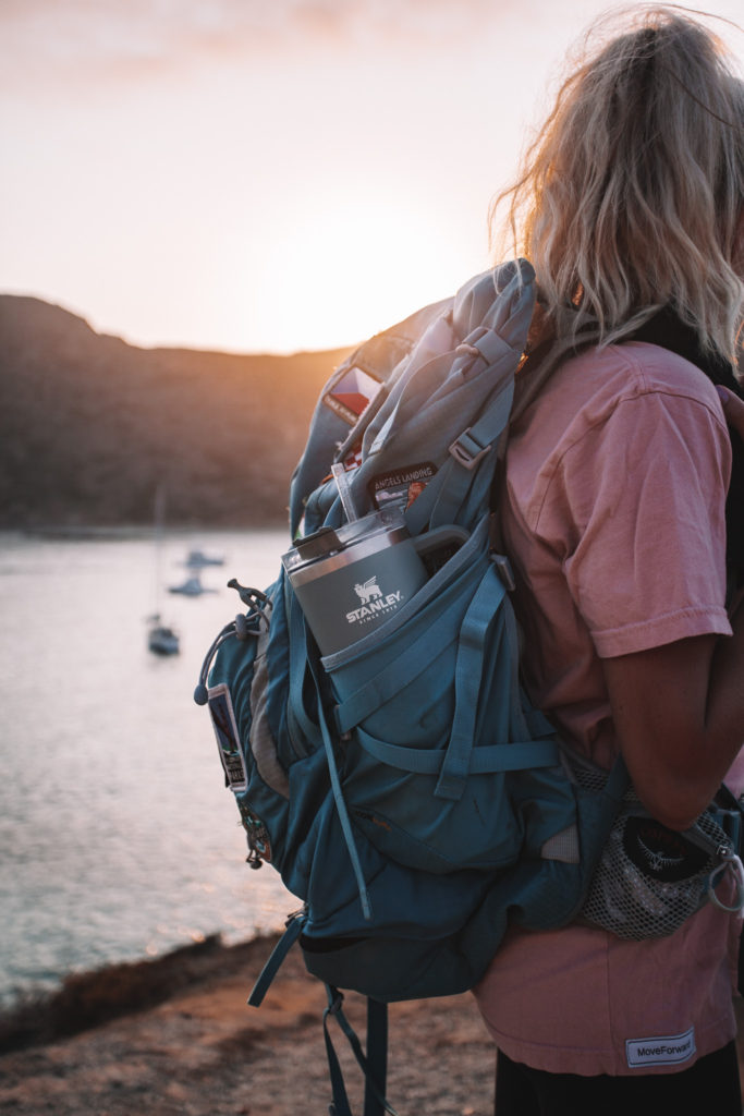 Girl with a backpacking backpack and her water bottle