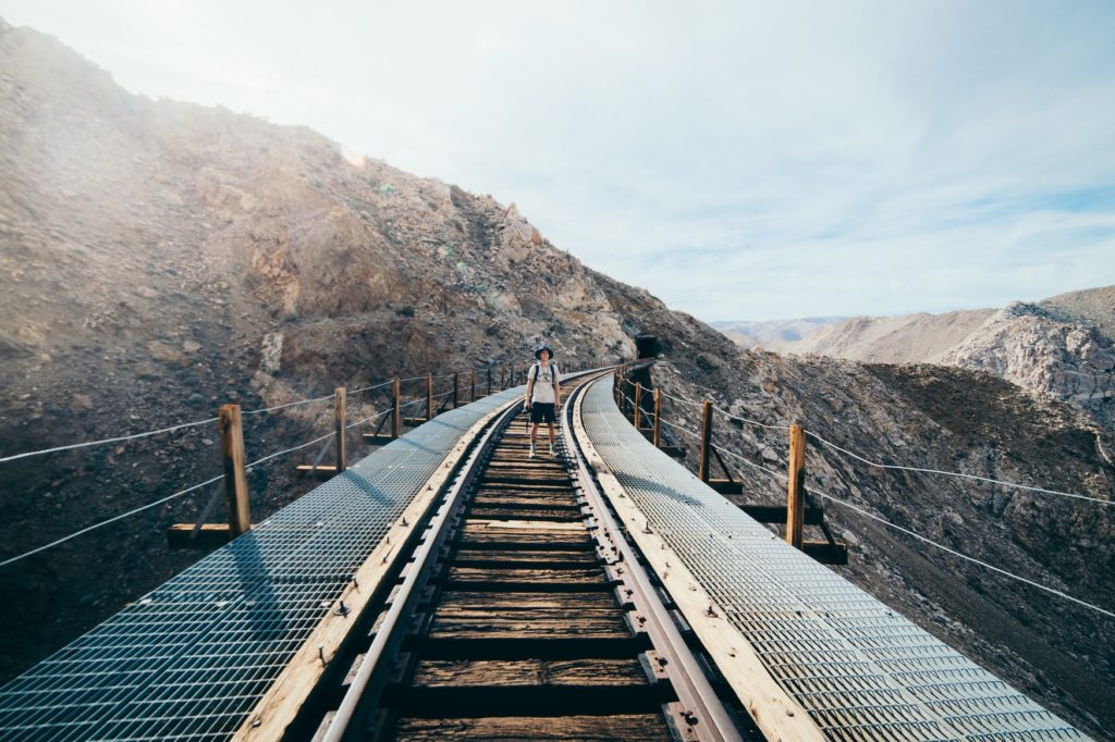 Man standing on the Goat trestle canyon which is a great hiking stop to make on your phoenix to san diego drive