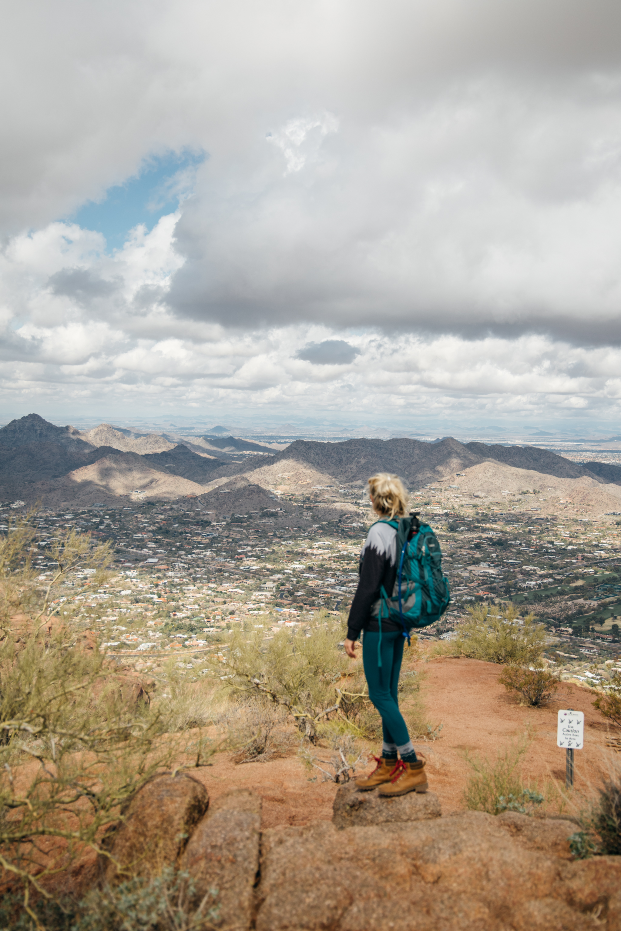 Girl standing looking at the views of Phoenix from atop Camelback mountain