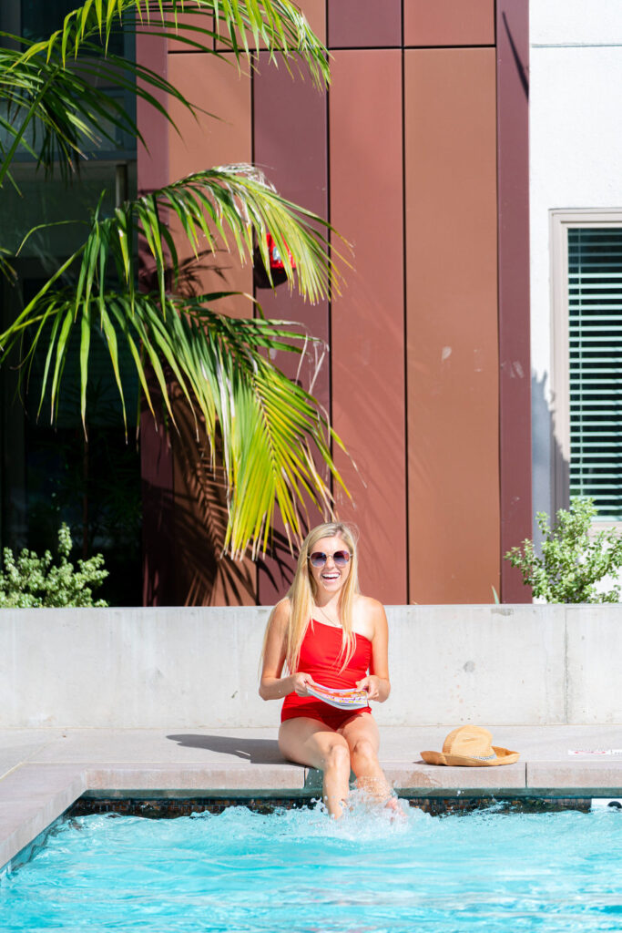 Girl sitting on the edge of a San Diego hotel pool
