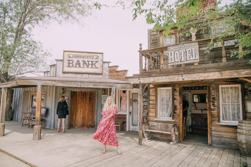 Chelsey standing in Pioneertown which is one of the things you must do in Joshua Tree