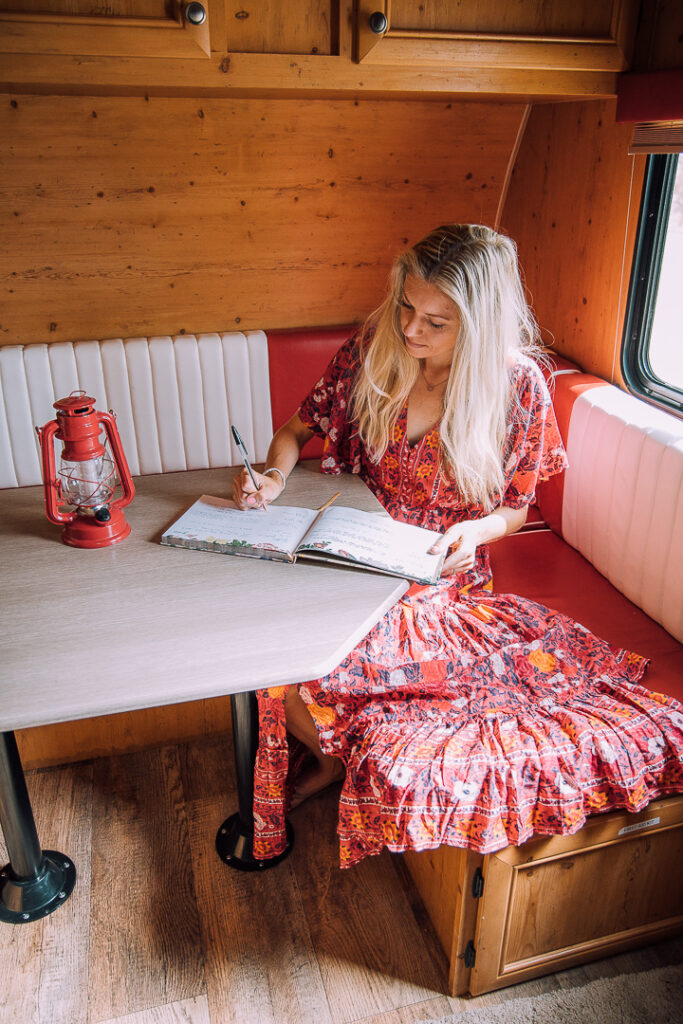 Chelsey signing a guest book in the trailer she stayed in near Joshua Tree
