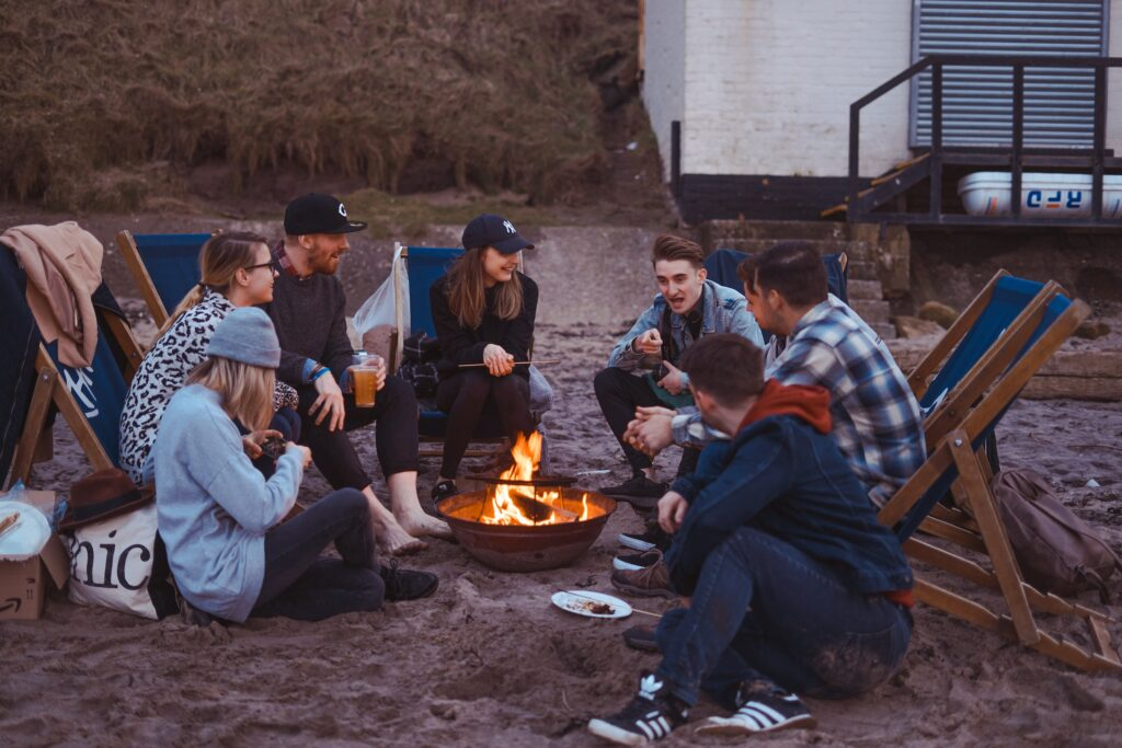 Friends sitting around a campfire on a friends camping trip
